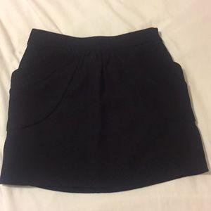 It has pockets! J.Crew black mini sz 2